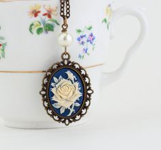 Necklace Purple and Ivory Flower Cameo by JacarandaDesigns on Etsy