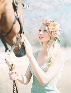 Bohemian bride - mint green Claire Pettibone wedding gown, flower crown, and with horses!