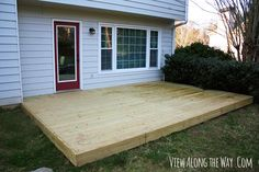 Kelley and her husband built this awesome deck over an existing concrete patio. Click through to see the transformation! (@Kelly at View Along the Way)