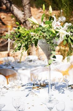 @Katelyn Pietras I like the martini glass idea... Superglam oversized Martini glass wedding centerpieces