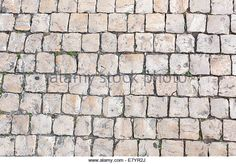 Closeup of Portuguese pavement. Sett texture, background - Stock Image
