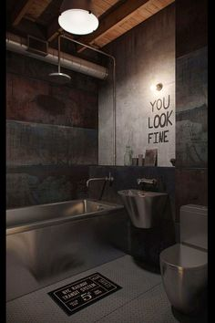 Industrial bathroom. Modern.  Love the mirror!  Lol