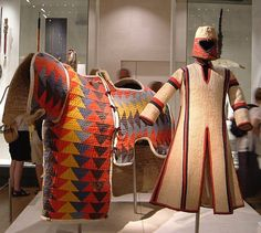 Sudanese quilted armor for horse and warrior, displayed in the British Museum, captured from the army of Mahdi Muhammad Ahmad ibn 'Abd Allah (Battle of Omdurman,1898). Made from several pieces of coloured cloth sewn together, stuffed with kapok (wool-like strands that surround the seeds of the silk cotton tree) creating a heavy garment.
