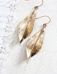 These are beautiful curled gold leaf earrings. The blackened patina adds details to this long gold leaf dangle. These are gorgeous earrings you