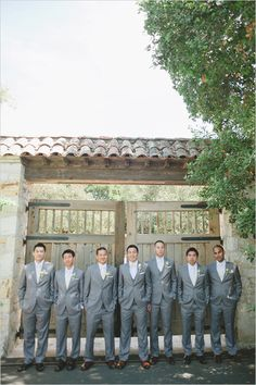 gray groomsman suits - bowtie for groom and skinny ties for his men.