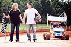 Love On The Speedway, Race Track Engagement Photos With Checkered Flags & Beer Showers Car Engagement Photos, Engagement Couple, Engagement Shoots, Engagement Ideas, Maternity Photography, Couple Photography, Photography Ideas, Wedding Pictures, Wedding Ideas