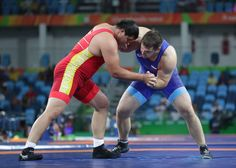 Ramonov of Kyrgyzstan and Sergey Semenov of Russia compete during the men's 130kg Greco-Roman wrestling qualifications in the Rio 2016 Summer Olympic Games at Carioca Arena 2.        -  Best images from Aug. 15 at the Rio Olympics:  2016