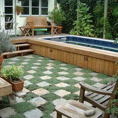 permeable deck, wood sides on above ground pool. Prettiest setting I've seen for an above ground pool.