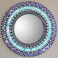 Awesome mirror!    Angie Heinrich has been creating mosaics in Seattle since 1998. Inspired by the rhythm of Moroccan art and architecture, Heinrich crafts pieces with soothing symmetries of stunning glass tiles and beads.