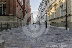 Jagiellońska   Street in the old part of Krakow city in Poland. Europe .Road leading to Collegium Maius Jagiellonian University. Evening time.