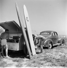 too cool - looks to be an original teardrop trailer and some of the heaviest surfboards on the planet