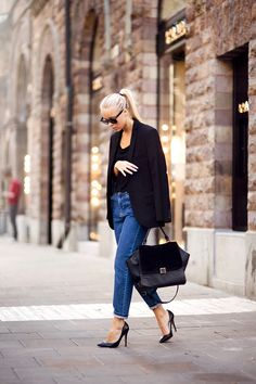 High-waisted jean well paired with black.