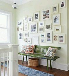 Love the way the white frames blend into the white wall.  And how its the whole wall!