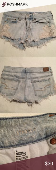 American Eagle denim shorts Denim shorts from American Eagle with lace trimmings on side, somewhat distressed at the bottom American Eagle Outfitters Shorts Jean Shorts