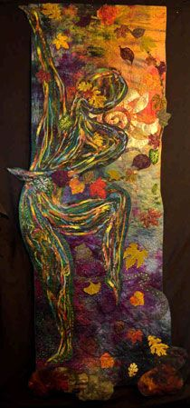 """Fall Fanfare by Ellen Ann Eddy ©2007 77"""" x 31"""" Irregularly shaped Hand-dyed cotton, and brocade, cut away appliqué, direct appliqué, machine embroidered & quilted; polyester, metallic, nylon threads, needle punched yarns, Angelina fibre, novelty yarn, self digitized computerized leaves"""