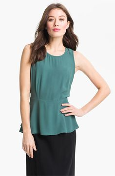 This peplum top with a pair of straight leg denim is great daywear that feels polished and on trend without draping. Add a vertical necklace and embellished sandals to complete the look. Eileen Fisher Silk Georgette Peplum Blouse (Online Exclusive) | Nordstrom