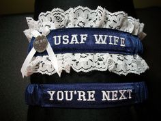 Air Force garter set with USAF Wife embroidered on it on navy blue satin and throw garter that's says You're next. $29.00, via Etsy.