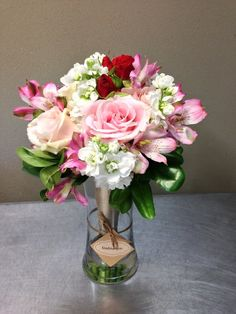 Bridesmaid's bouquet of pink and white flowers with a touch of red to tie in with the bridal bouquet. Flowers from Seasonal Celebrations.