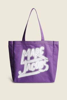 "Tote your essentials in style with this viant, neon lights version. Encompassing the fun, whimsical spirit of Marc Jacobs, this tote is not only fun to carry, but spacious enough to fit everything you need to easily transition from the workday to the weekend.buDimensions/b/u14""W x 14 1/2""H x 4 1/2""D(37cm x 36 1/2cm x11 1/2cm)buFeatures/b/u•Two top handles•Roomy interior•100% Cotton"
