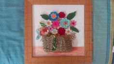 Cesta con flores de ganchillo | Aprender manualidades es facilisimo.com