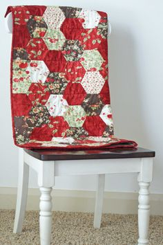 Lola Griffin look at this quilt. Christmas Hexagon Hexie Quilt!