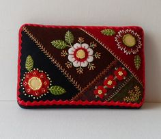 Handmade Felted Wool Red Blossoms Needle Cushion - 8 1/4L x 5 1/4W x 1 1/2 H. Felted wool crazy patch with beautiful red blossoms accented with