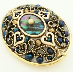 """Michal Golan Heart Abalone Pin Pendant Combo Oval brooch by Michal Golan featuring hearts, abalone and iridescent dark blue. Can be worn as a pin or pendant. Measures 1 11/16"""" by 1.25"""". Very good condition. Michal Golan Jewelry Brooches"""