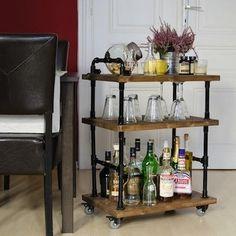 Amp up your industrial chic style with a bar cart made from metal pipe pieces and wood boards. All the materials can be found at your local hardware store, but be sure to add casters on the bottom to make the heavy cart easily portable.