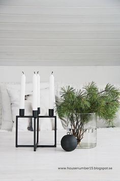 Scandinavian Christmas inspiration - simple evergreen branches in a glass vase with House Doctor candle holder