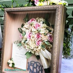 Beautifully #preservedbouquet with the wedding invitation and boutonnière, all displayed in a custom shadow box. #floralpreservation