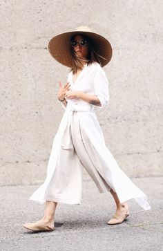 minimalist summer silhouette with long white layers and linen cropped  pants: