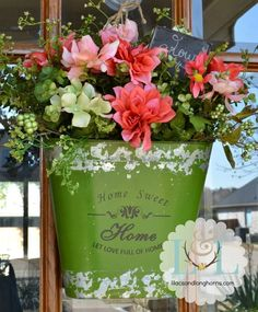 """Create a simple and beautiful spring """"wreath"""" with a tin bucket!  Spring Flowers   http://www.lilacsandlonghorns.com/spring-flowers.html"""