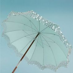what a beautiful outdoor parasol. Castles Crowns and Cottages Under My Umbrella, Beach Umbrella, Sun Umbrella, Umbrella Lights, Bling Bling, Aqua, Umbrellas Parasols, Singing In The Rain, Sparkles Glitter