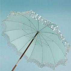 Love the idea of a blingy umbrella.  Make even gray days sparkle & shine!  :o)