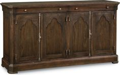 Journeyman's Door Cabinet  At the turn of the century, few could ply their trade before completing an apprenticeship and with good reason. The Journeyman's Door Cabinet in a Loft finish demonstrates the kind of great design experience can produce, with two drawers built into the molding, one featuring a silver tray. Two adjustable trays are hidden behind the four doors.