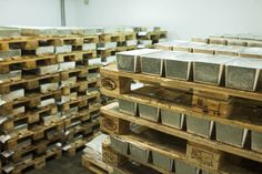 Pallets loaded with newly cast silver bullion bars sit at a smelting plant in Glogow,. Gold Bullion Bars, Silver Bullion, Gold Reserve, Gold Money, Silver Bars, Crystals And Gemstones, Precious Metals, Wood, Stock Options