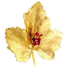 Tiffany & Co. Ruby Gold Textured Leaf Pin. Tiffany & Co pin 18k yellow gold circa 1950-1960 hand textured Leaf design with bright red Rubies.