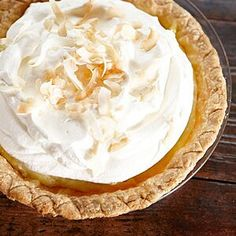 scissors or a sharp knife, trim the dough so it overhangs the tin by about 1 inch. Turn overhanging dough under, forming a rim, and crimp the edges of the pastry. Lightly prick the bottom of the dough with a fork; brush the rim with Double Coconut, Best Coconut Cream Pie, Cream Pie Recipes, Custard Filling, Classic Desserts, Thing 1, Dried Beans, Banana Cream, Toasted Coconut