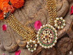 22 carat gold metal seven strings gold swirls long chain with pretty and trendy pearl embellished round motif in the center, Studded with. Indian Wedding Jewelry, Bridal Jewelry, Beaded Jewelry, Gold Jewelry, Pearl Jewelry, Pearl Necklace, India Jewelry, Jewelry Sets, Jewelry Stores