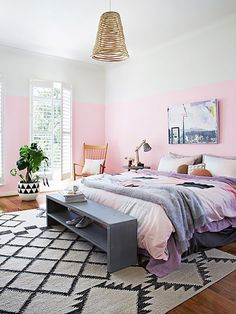 2016 rose quartz -This lively bedroom blends two very big trends in décor: rose quartz and a half-painted wall. The black-and-white graphic rug and basket pendant offset the brightness of the walls and bedding.