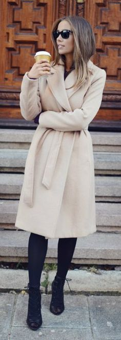 Emilie Tømmerberg rocks the robe coat trend, paring this cream coat with funky heels and black tights. Coat: H&M.... | Style Inspiration