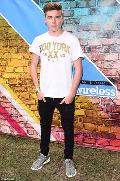 Casual: Brooklyn sported a casual white T-shirt and jeans teamed with Nike trainers for his appearance at the annual music festival, which will see rappers Drake, Kendrick Lamar and Nicki Minaj take to the stage