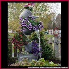 Dollar Store Crafter: How To Make A Tipsy Watering Can Garden Fountain