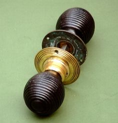 Ebonised wood and brass beehive door knob