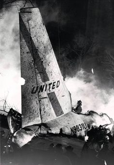 The wreckage of United Airlines Flight 553 smolders in the neighborhood of West 70th Place after crashing into a row of bungalows while approaching Midway Airport.