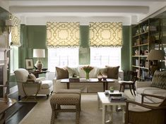Phoebe Howard: Sophisticated green living room with glossy green lacquer walls paired with ivory and ...