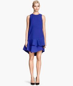 Short, sleeveless dress in scuba-look fabric with ruffles at hem | H&M Trend