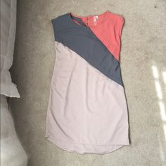 Sleeveless mid length dress from Francesca's Perfect for Spring or Summer.  100% polyester high low dress.  It's peach, gray and a pale pink.  Good condition.  No trades. Dresses