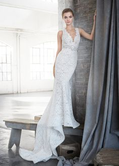Style 3611  Lazaro bridal gown - Ivory venise lace trumpet bridal gown over cashmere chiffon, V neckline with high back, natural white stone belt at waist, chapel train.