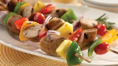 Sweet apple chicken sausage kabobs coated in a homemade apple marinade is a tasty appetizer or dinner item for summertime grilling.
